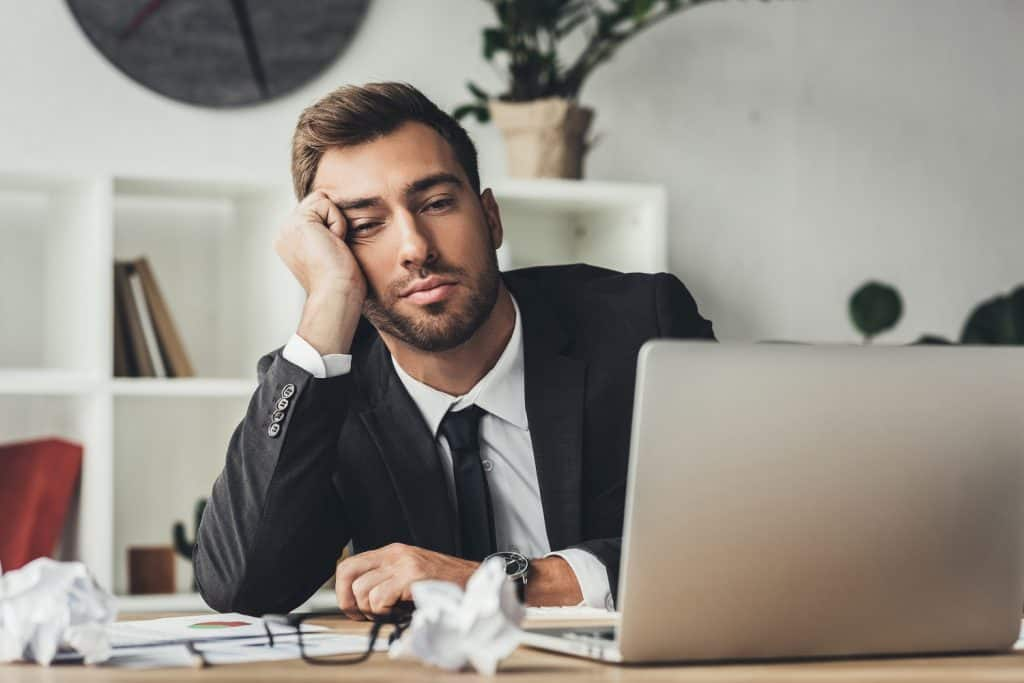 Man working who thinks sleep is overrated